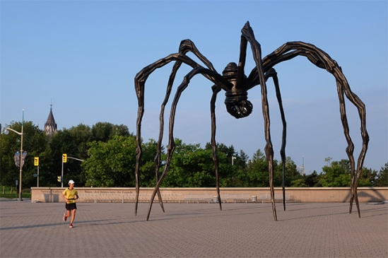 Maman: sculpture by Louise Bourgeois (with jogger)